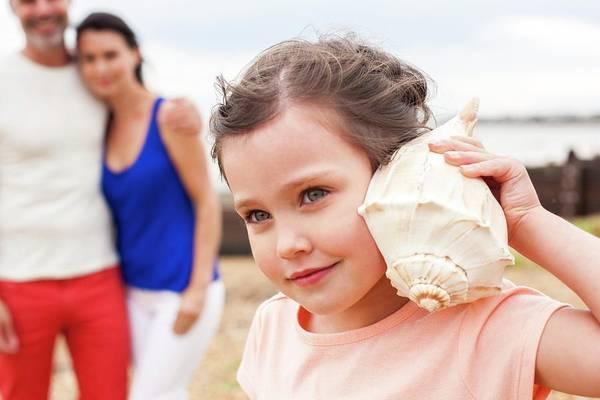Three Seashells Photograph - Girl With Seashell by Ian Hooton