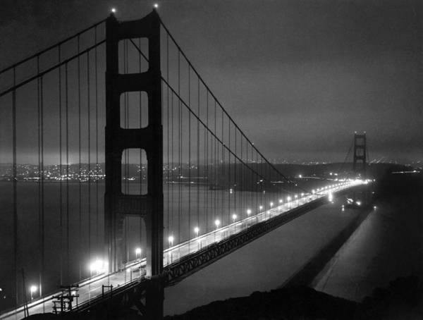Photograph - Golden Gate Bridge At Night by Underwood Archives