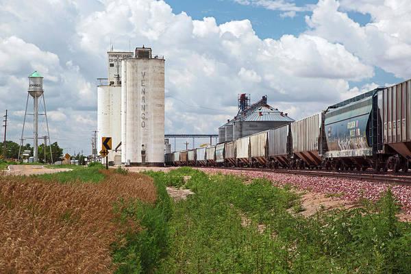 Elevators Wall Art - Photograph - Grain Elevators And Railway by Jim West