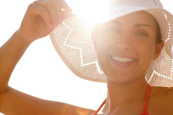 Sunbather Wall Art - Photograph - Happy Woman Wearing A Sunhat by Ian Hooton/science Photo Library