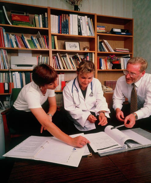 Staff Photograph - Hospital Conference: Staff Discuss Hospital Issues by Simon Fraser/science Photo Library