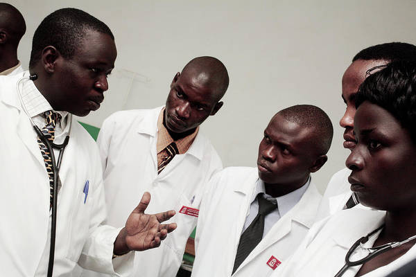 Uganda Wall Art - Photograph - Hospital Doctors by Mauro Fermariello/science Photo Library