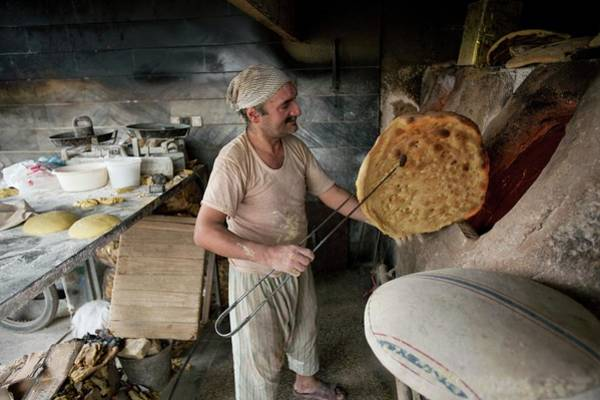 Wall Art - Photograph - Iranian Bakery by Peter Menzel/science Photo Library
