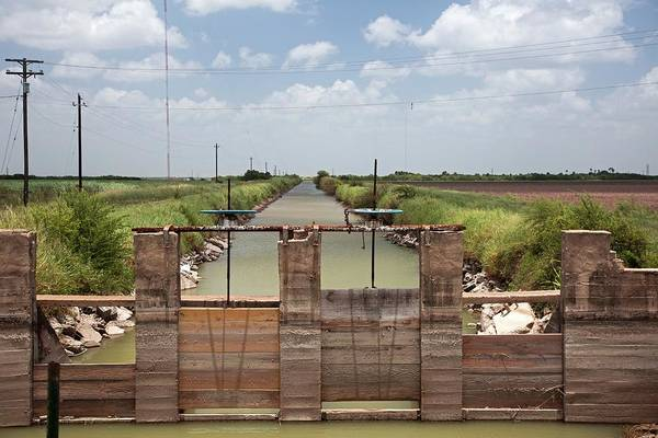Wall Art - Photograph - Irrigation Canal by Jim West