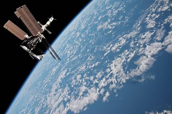 International Space Station Photograph - Iss And Space Shuttle by Nasa/science Photo Library