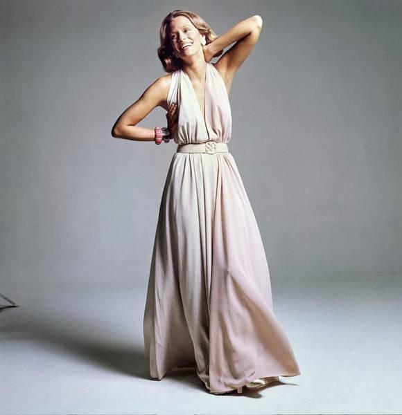 Lauren Hutton Wearing A Galanos Dress Art Print by Bert Stern