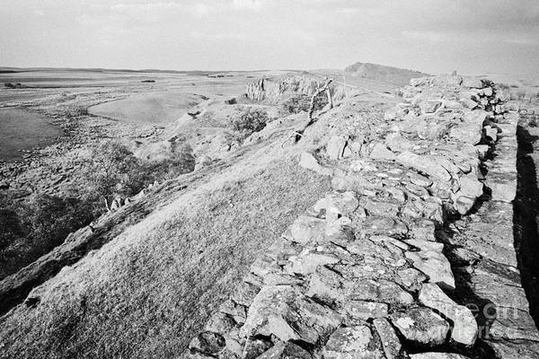Hadrians Wall Photograph - Looking Down From A Section Of Hadrians Wall At Walltown Crags Northumberland Uk by Joe Fox
