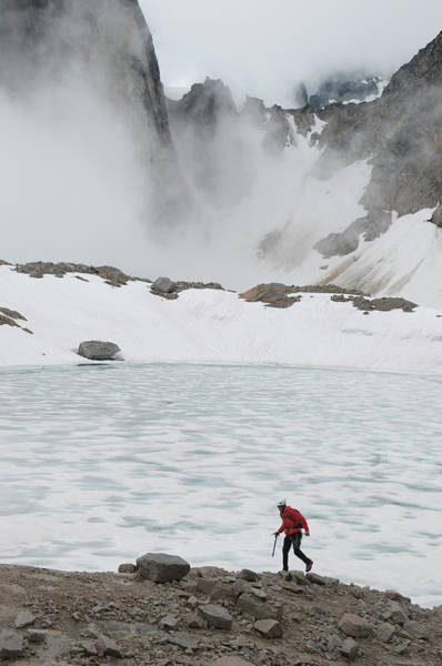 Walking In The Rain Wall Art - Photograph - Man Hiking Through Granite And Glaciers by Kennan Harvey