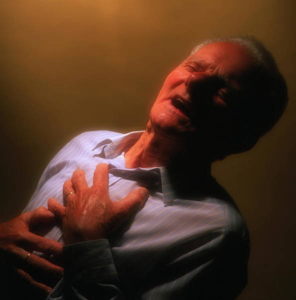 Wall Art - Photograph - Man Holds His Chest Due To Angina Or Heart Attack by Saturn Stills/science Photo Library