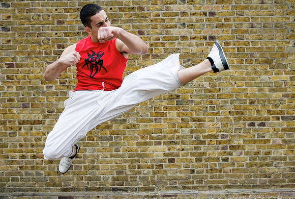 Agile Photograph - Martial Arts Kick by Gustoimages/science Photo Library