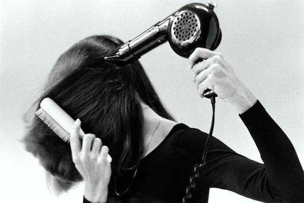 Dry Photograph - Model Blow Drying Hair by Mike Reinhardt