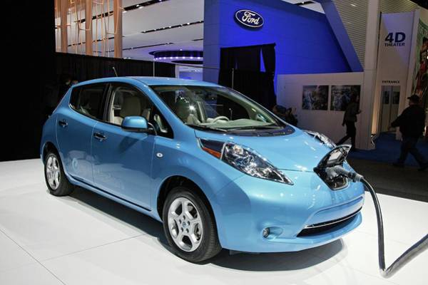Detroit Auto Show Photograph - Nissan Leaf Electric Car by Jim West