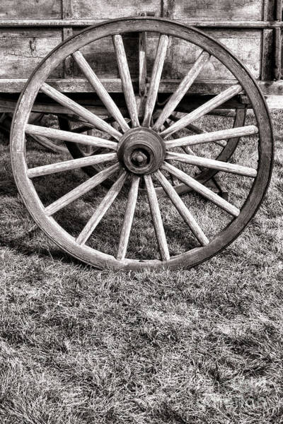 Schooner Photograph - Old Wagon Wheel On Cart by Olivier Le Queinec
