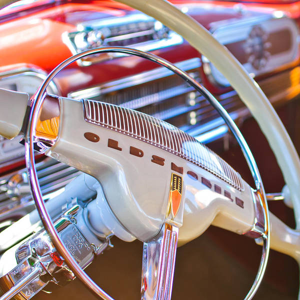Steering Wheel Wall Art - Photograph - Oldsmobile Steering Wheel Emblem by Jill Reger