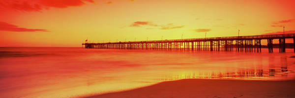 Wall Art - Photograph - Pier In The Pacific Ocean At Dusk by Panoramic Images
