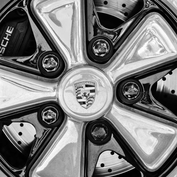 Photograph - Porsche Wheel Rim Emblem by Jill Reger