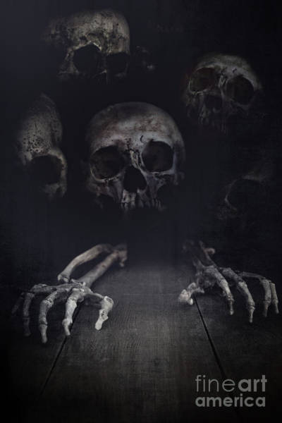 Photograph - Skeletal Hands And Skulls Creeping Out From The Dark by Sandra Cunningham