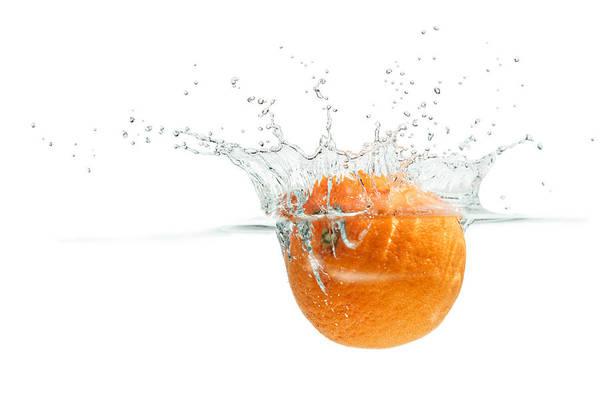 Photograph - Splashing Orange by Peter Lakomy