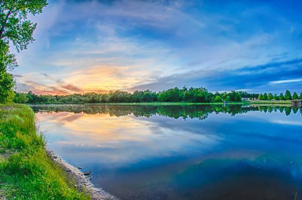 Photograph - Sun Setting Over A Reflective Lake by Alex Grichenko