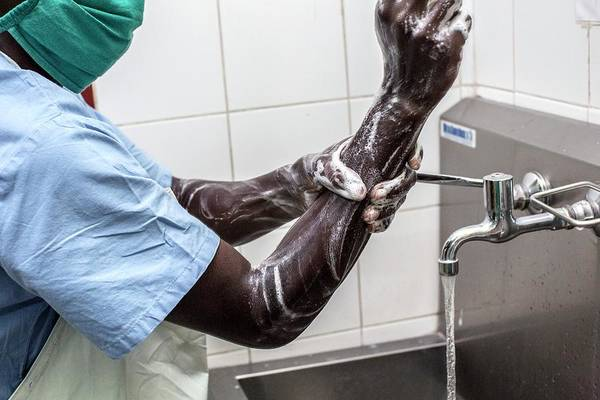 Wall Art - Photograph - Surgeon Washing His Hands by Mauro Fermariello/science Photo Library