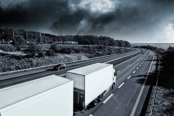 Wall Art - Photograph - Trucks On Highway by Christian Lagerek/science Photo Library
