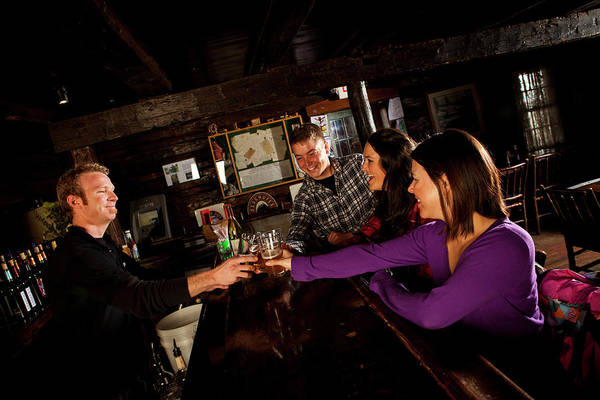 Bar Tender Photograph - Two Men And Two Women Having Beer by Trevor Clark