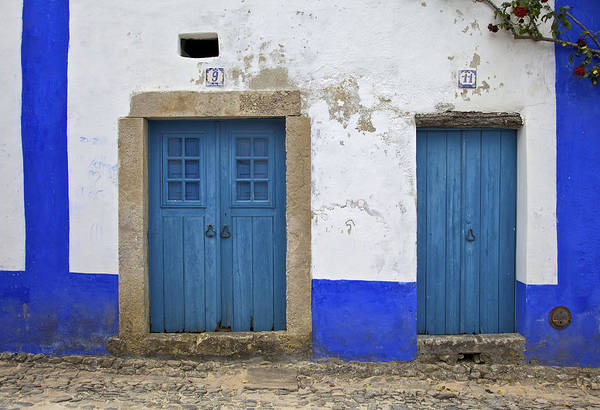 Photograph - Two Wood Faded Blue Doors Of The Medieval Village Of Obidos by David Letts