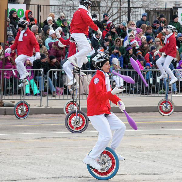 Juggler Photograph - Unicyclists At A Parade by Jim West