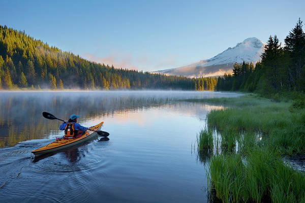 Wall Art - Photograph - Usa, Oregon A Woman In A Sea Kayak by Gary Luhm