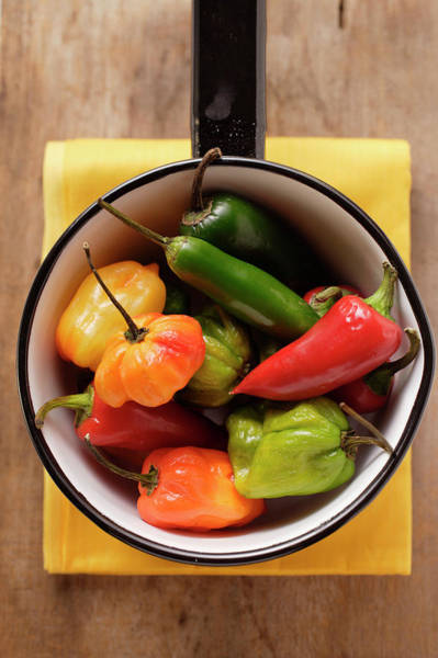 Wall Art - Photograph - Various Chili Peppers In Pan by Foodcollection