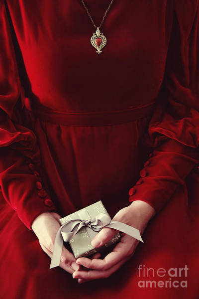 Photograph - Woman In Red Dress Holding Small Gift by Sandra Cunningham