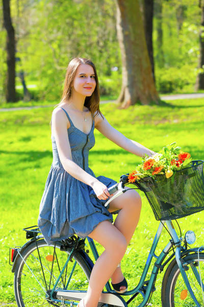 Wall Art - Photograph - Woman Riding Bicycle In Park by Wladimir Bulgar/science Photo Library