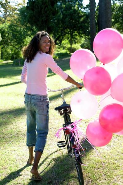 Breast Cancer Awareness Wall Art - Photograph - Woman With A Bicycle And Balloons by Ian Hooton/science Photo Library