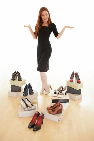 Dress Shop Photograph - Woman With Shoes by Ian Hooton