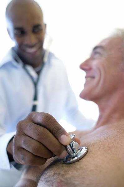 Examine Photograph - Medical Consultation by Ian Hooton/science Photo Library