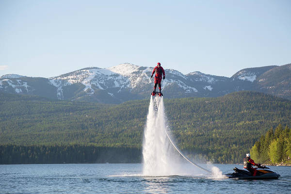 Wall Art - Photograph - A Man Flyboards On Whitefish Lake by Craig Moore