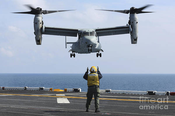 Mv-22 Photograph - An Aviation Boatswains Mate Directs by Stocktrek Images