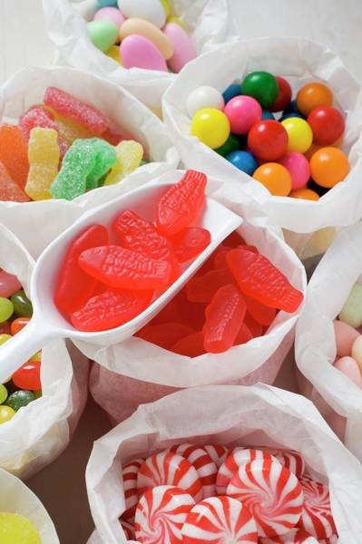 Wall Art - Photograph - Assorted Sweets In Paper Bags (usa) by Foodcollection