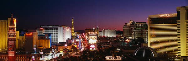 Harrahs Photograph - Buildings Lit Up At Night, Las Vegas by Panoramic Images