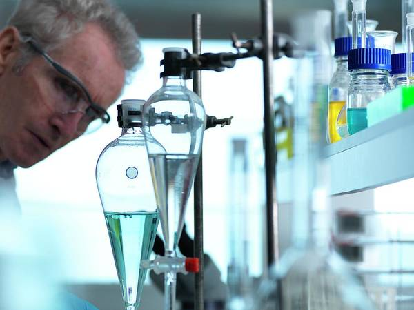 Examine Photograph - Chemical Research by Tek Image/science Photo Library