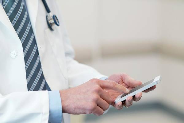 Wall Art - Photograph - Doctor Using Smartphone by Science Photo Library