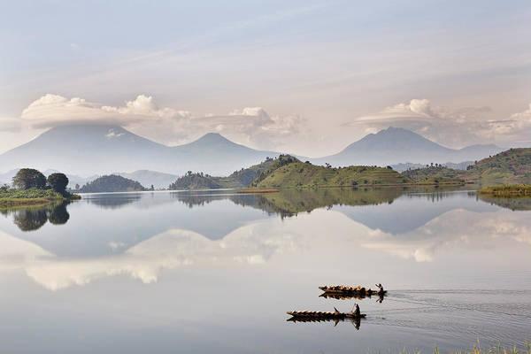 Paddle Boats Photograph - Dugout Canoe Floating On Lake Mutanda by Martin Zwick