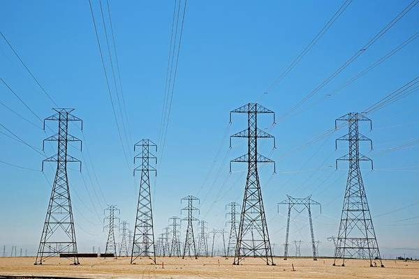 San Joaquin Valley Photograph - Electricity Pylons by Jim West