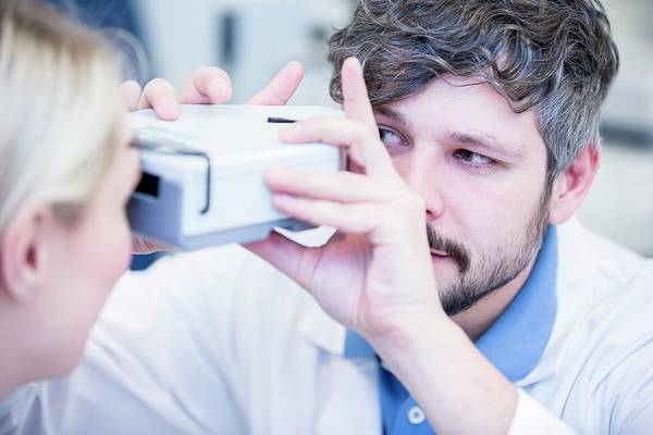 Apply Photograph - Female Patient Having Eye Examination by Science Photo Library