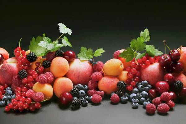 Wall Art - Photograph - Fruit Still Life With Stone-fruit, Berries And Leaves by Foodcollection