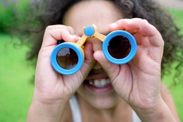 Parks And Recreation Photograph - Girl Using Binoculars by Ian Hooton/science Photo Library
