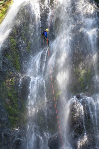 Wall Art - Photograph - Man Canyoning Down A Waterfall by Frank Huster