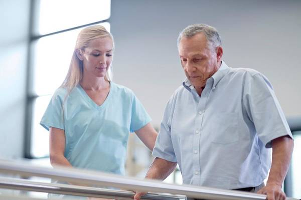 Wall Art - Photograph - Nurse With Senior Man Using Parallel Walking Bars by Science Photo Library
