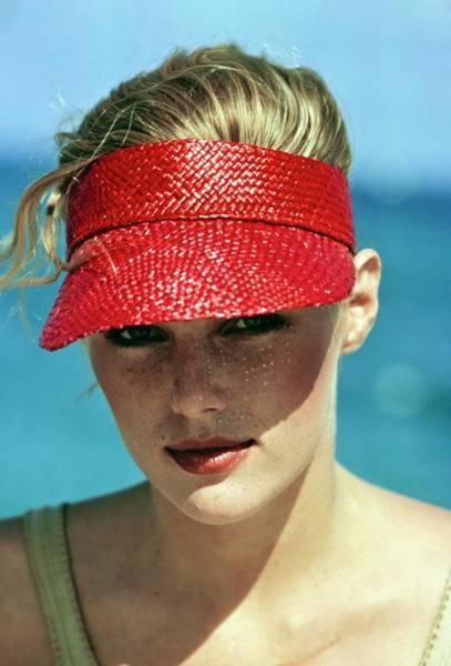 Photograph - Patti Hansen Wearing A Red Visor by Arthur Elgort