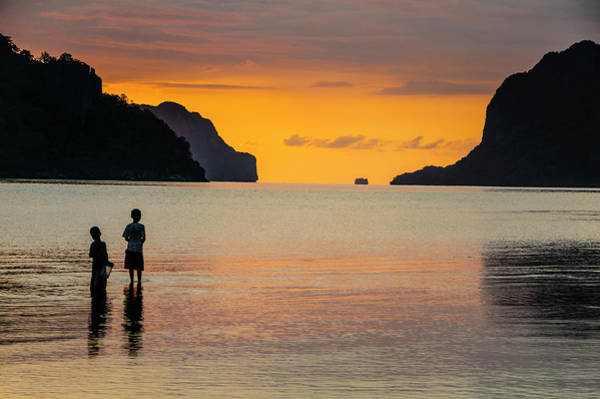 Archipelago Photograph - Silhouette Of Boys Fishing At Sunset by Michael Runkel